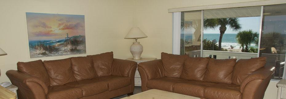 Rooms 11 and 12 - Deluxe Beach Front One Bedroom Apartment- Living room